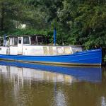 Boot van Rijkswaterstaat in de IJssel, vlak bij de Doorslag